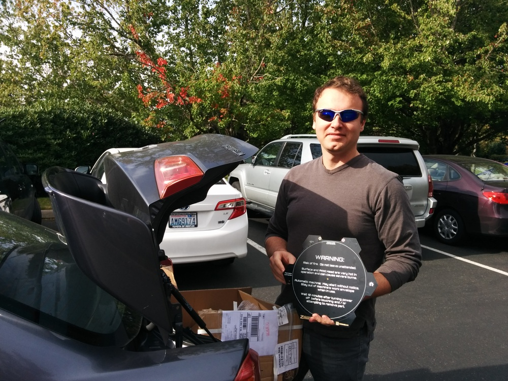 "MikeZ of Z-Designs making a special delivery.  I am sure one of these days someone in our business park will call the cops on ""two sketchy looking dudes exchanging boxes out of the back of their cars"", just about every day at lunch time."
