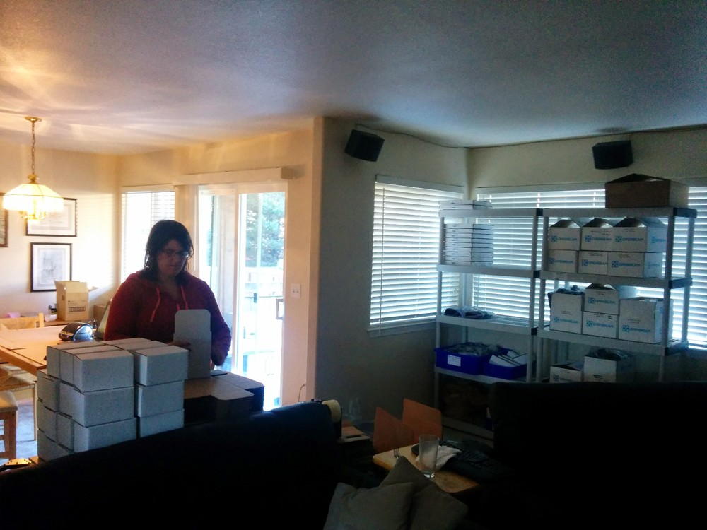 My lovely wife Rachel helping with folding boxes.  3 people are about the max # of people that can work comfortably without stepping over each other.