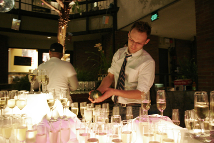 Kasper pours champagne for guests