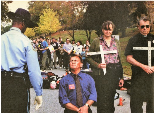 Martin Sheen, Davida Coady, and Father Bill O'Donnell protesting at the former School of the Americas at Fort Benning, Ga. in 2001. (Coady family photo).