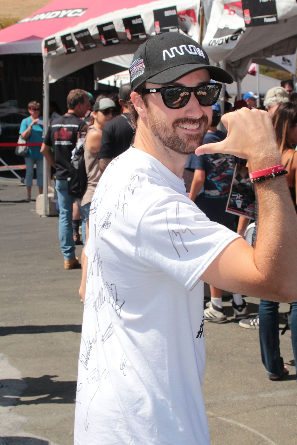 James Hinchcliff displays his Justin Wilson tribute shirt signed by teh drivers.
