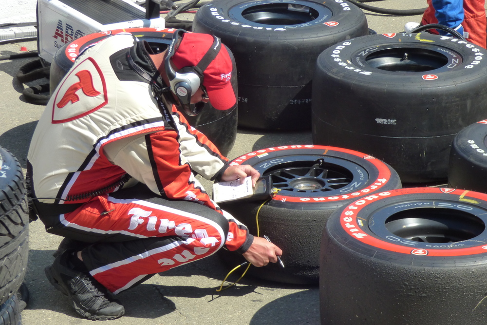 A Firestone tire engineer takes some measurements.
