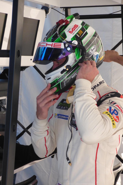 Nick Tandy helmets up.