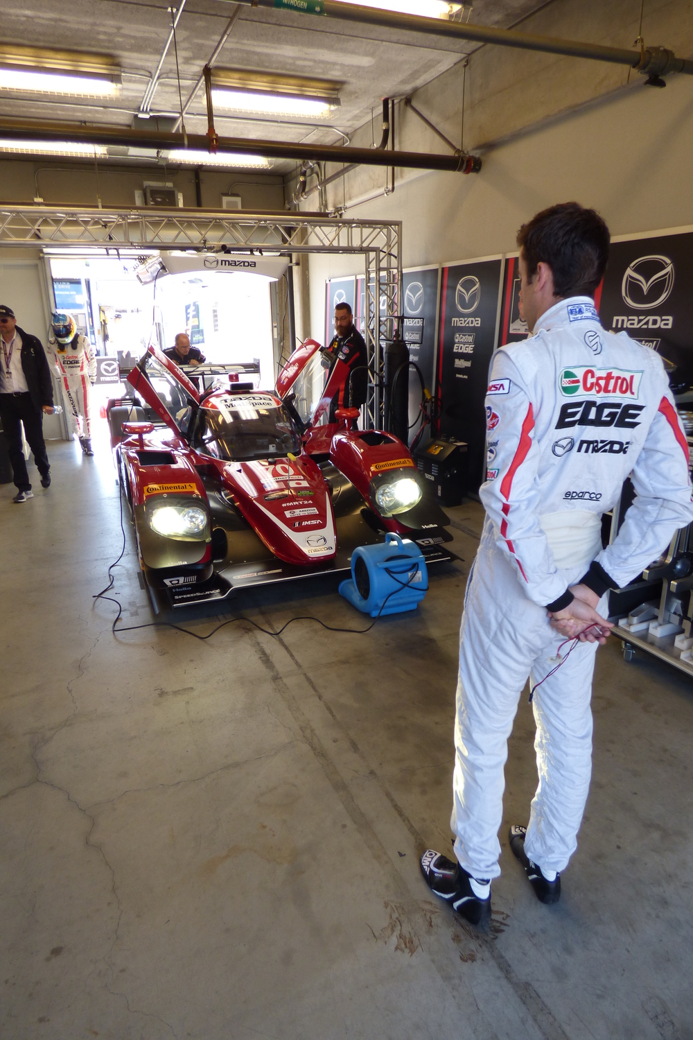 The Mazda pilots perform a little pre race car whispering