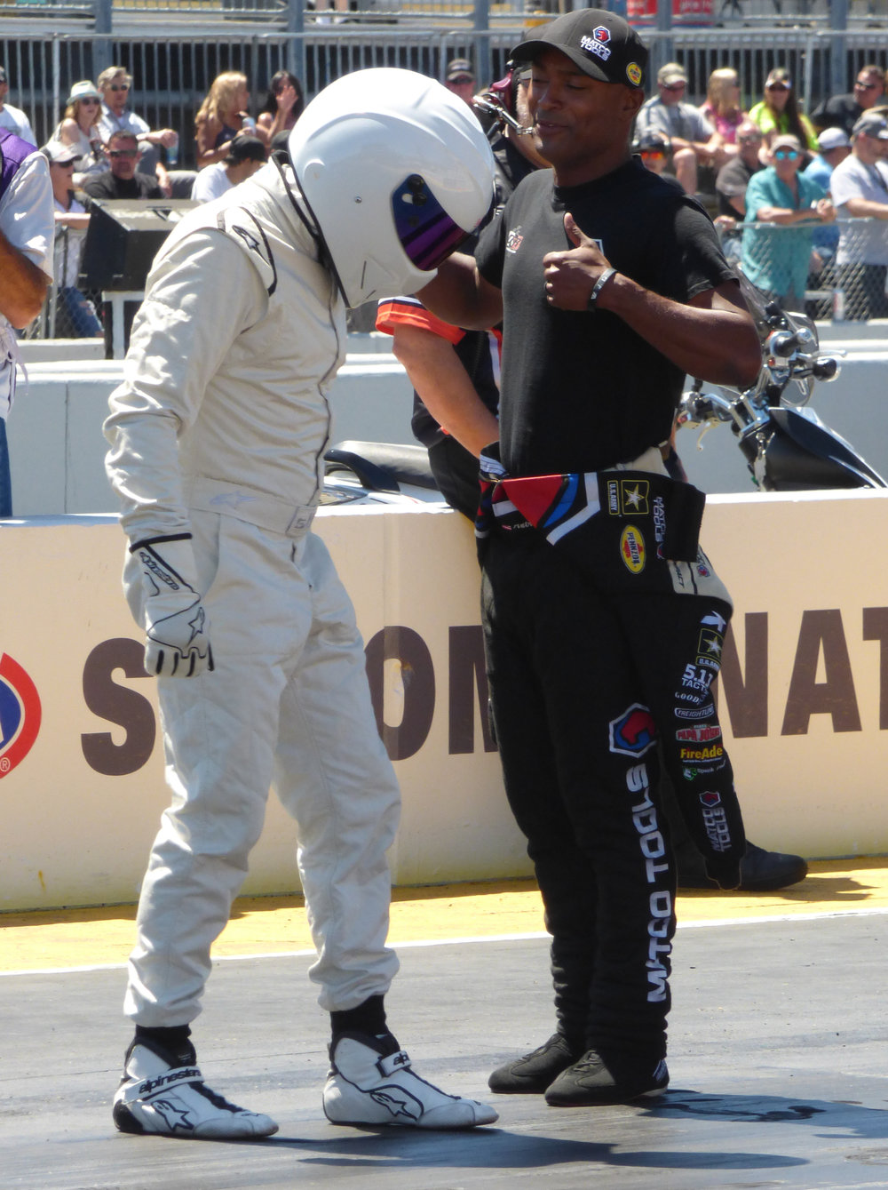 The Top Gear's The Stig checks the grip level with guidance from 3 time Top Fuel Champion Antron Brown