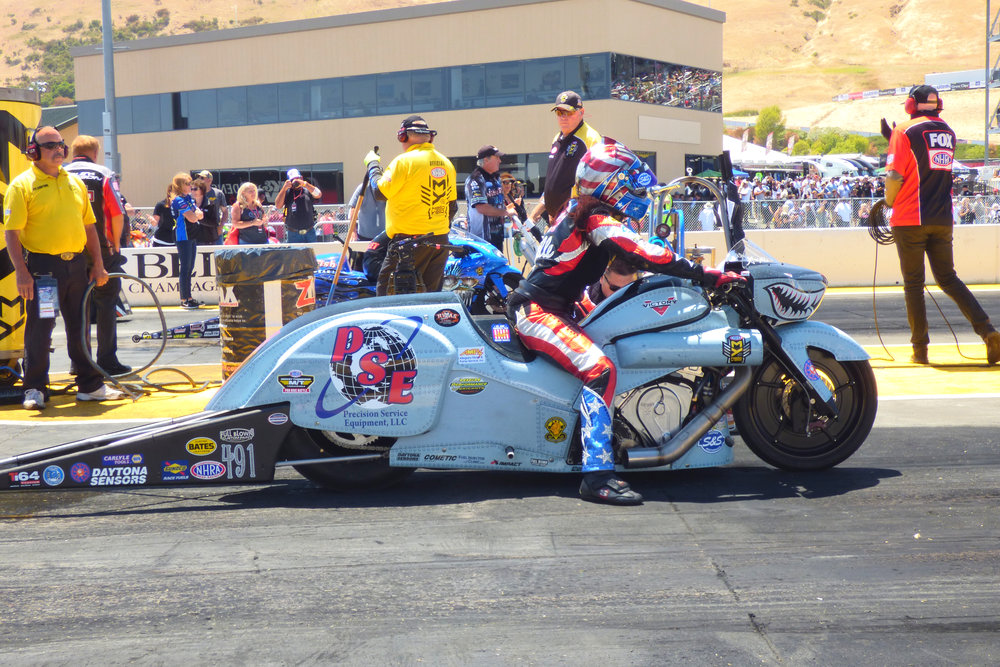 Angelle Sampey stages her PSE/Team Liberty Racing Victory Magnum in the Mello Yello - Pro Stock Motorcycle class.