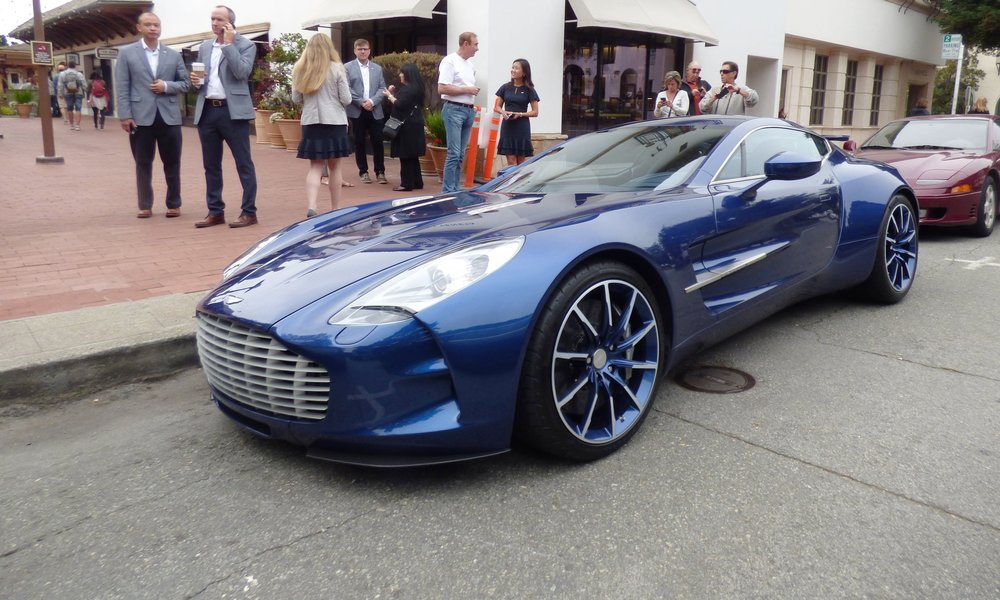An Aston Martin One-77 on Ocean Avenue in Carmel. This is just one example of a unicorn spotting from a past Car Week.