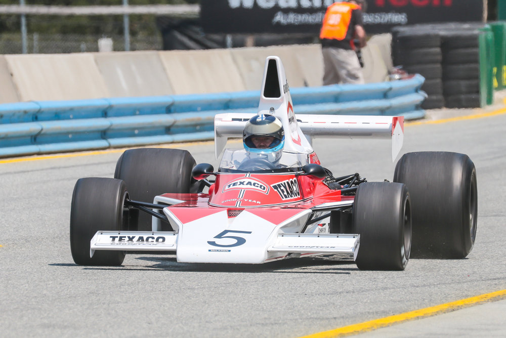 At the '17 Rolex Monterey Motorsports Reunion two time Formula 1 World Champion Mika Häkkinen drove the McLaren M23. Copyright The Loud Pedal