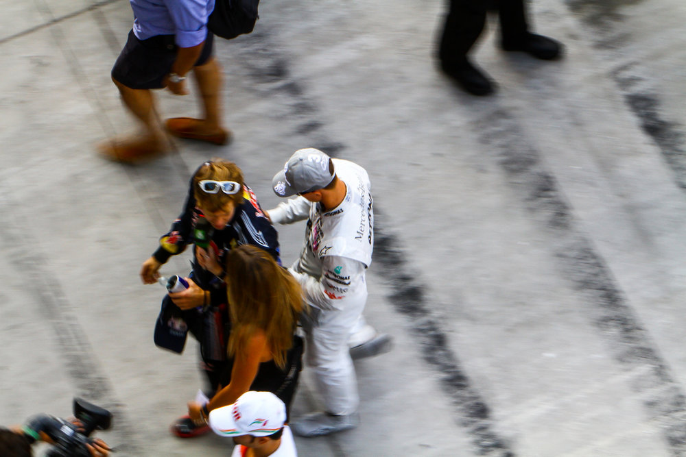 During the pre-grid at the 2010 Formula 1 Abu Dhabi Grand Prix. Schumacher plays a prank on a young Vettel prior to the race. Right after this moment they exchanged greetings and talked for a minute. Vettel would claim his first world title when the race was over. Copyright: Mark Farouk, The Loud Pedal