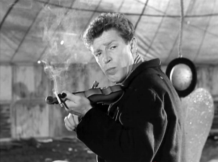 l Matto plays one og Nino Rotas themes on his mini violin in Federico Fellinis La Strada(1954)