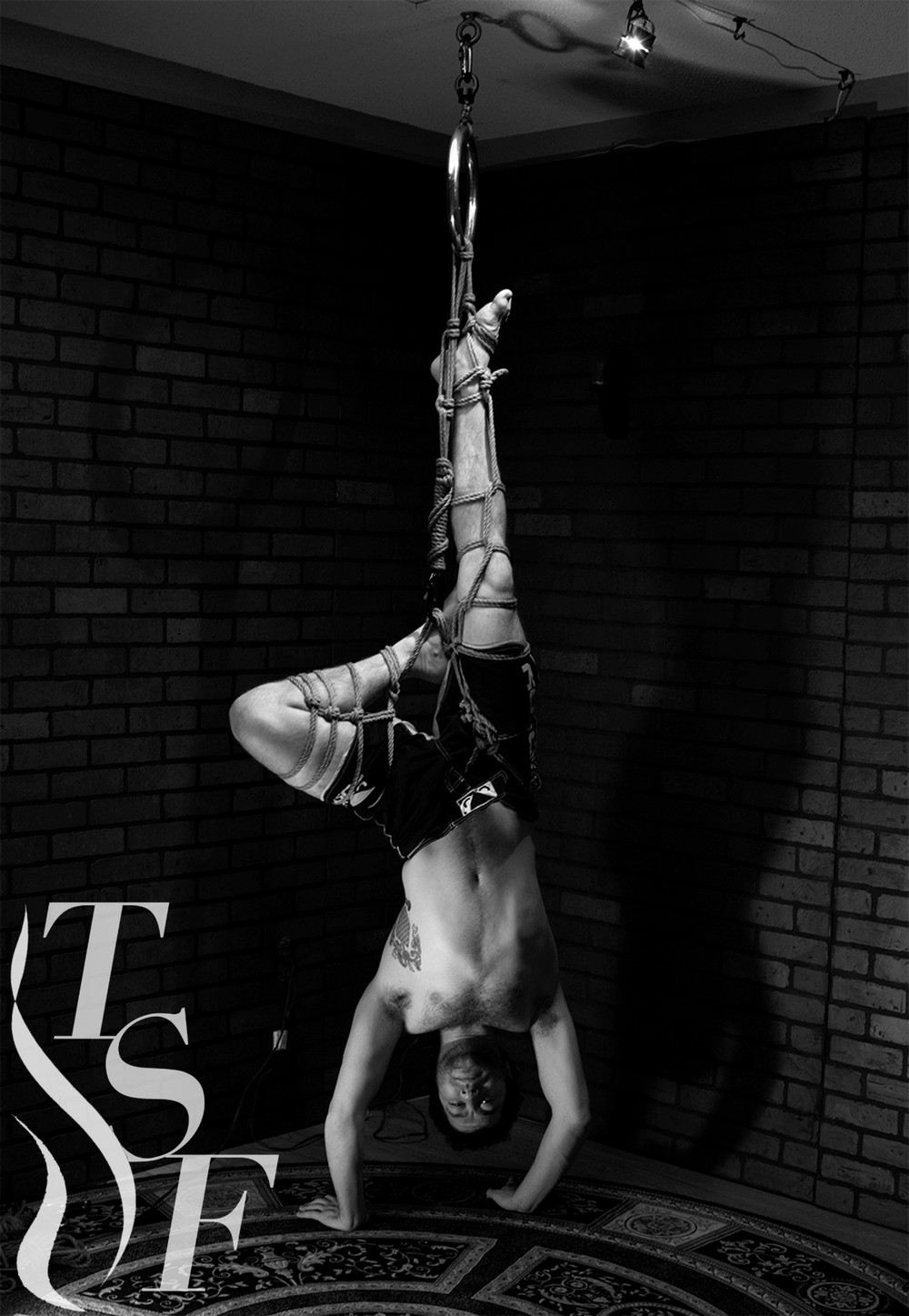 Rheb is being suspended by our jute rope. Lookin' good, sir!   Disclaimer: While this looks super amazing, we advise that you do not attempt suspension without proper supervision and/or training.