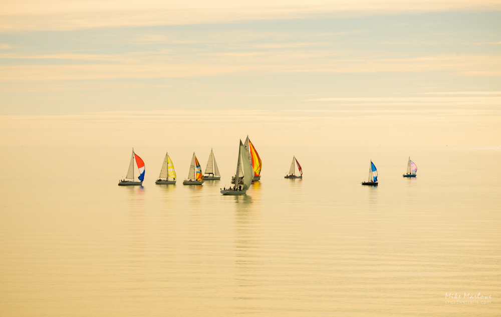 A surreal dreamy image of yachts in the early morning mist. Southern England near Eastbourne.