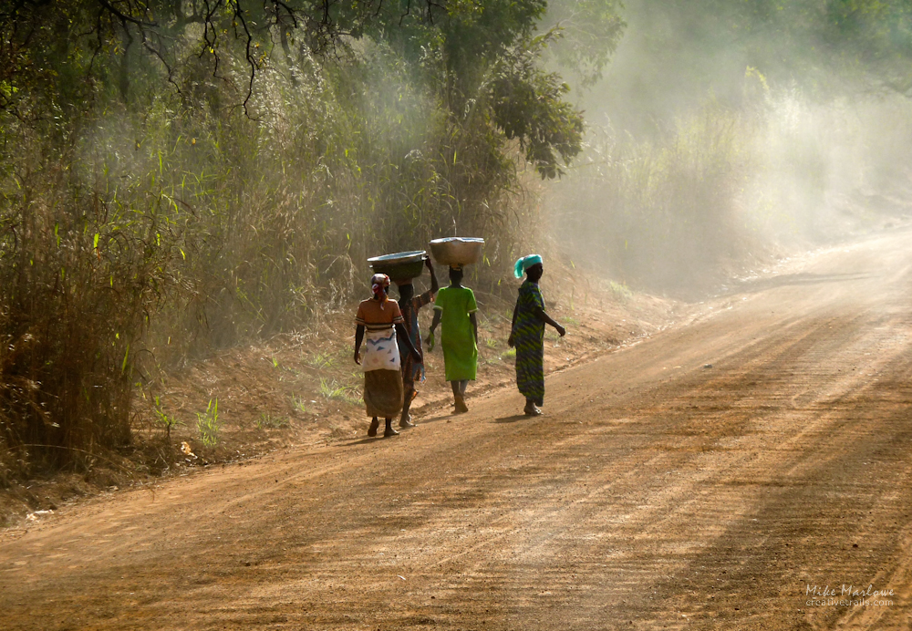 African women on the way to collect water in the early morning