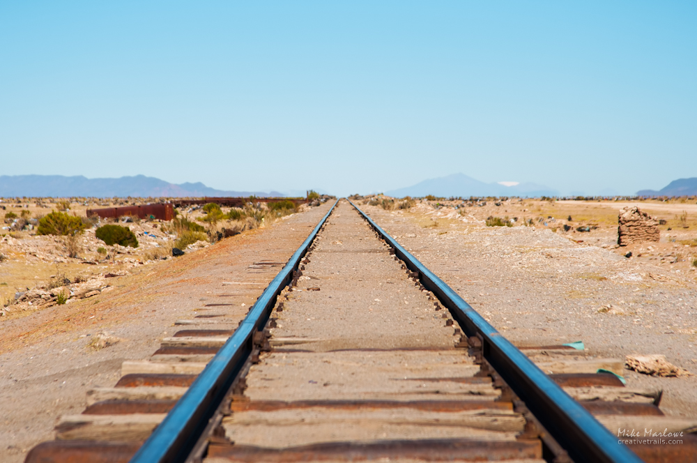 Train tracks on Salar de Uyuni, or Salt Flats in Bolivia. Built in the 19th century, the railroad was used to transport minerals to teh pacific coast.