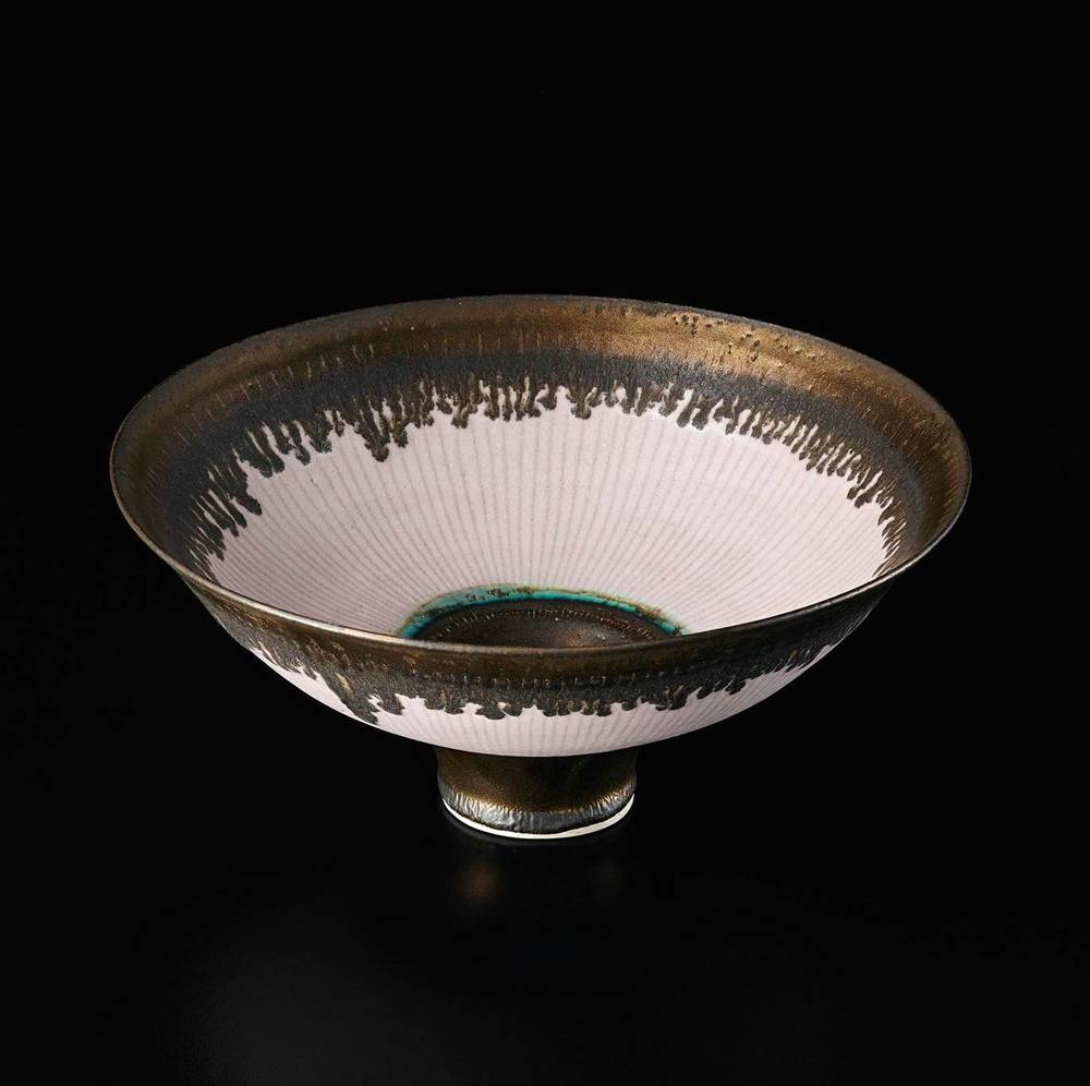 This Lucie Rie Footed Bowl sold in Ocotber 2015 for £68,500, more than double it's estimate. You might just be buying the next Lucie Rie by investing in modern ceramics!