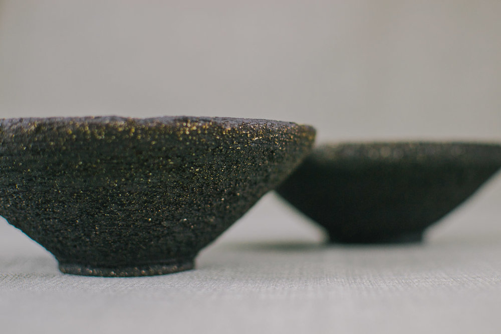 Black bowls from the side.jpg