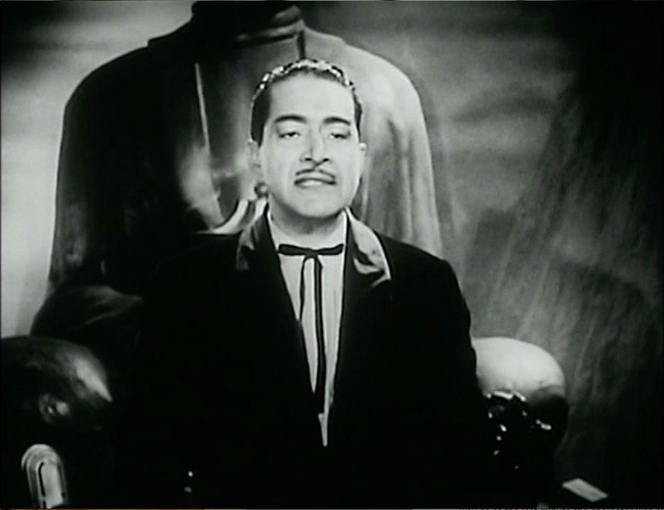 J Carrol Naish as Dr Daka in a costume not that different from the one The Joker wore in the early 1940s.
