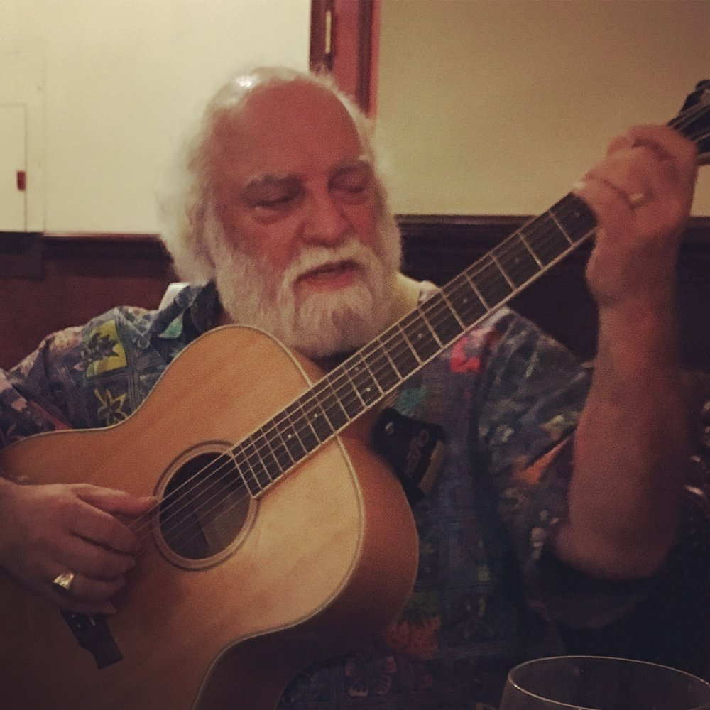 Joe Ferrara Plays a song for us at the end of the meal. Great musician.