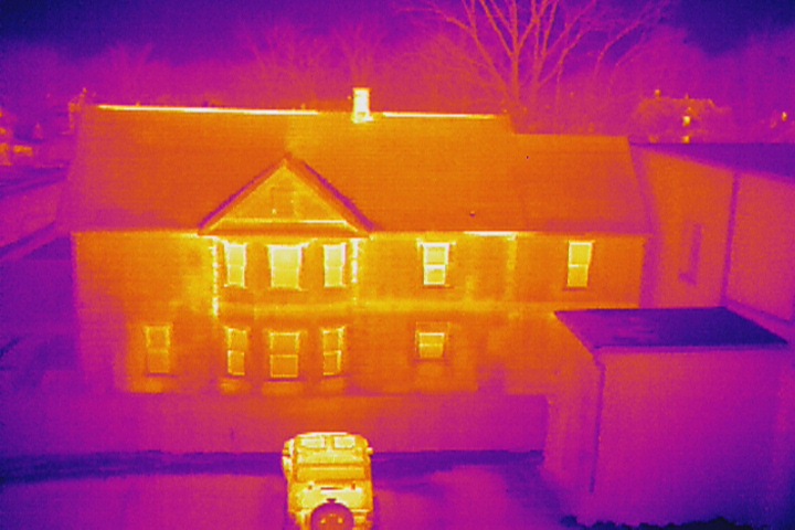 Thermal Imaging detects heat loss from a residence during an aerial drone inspection