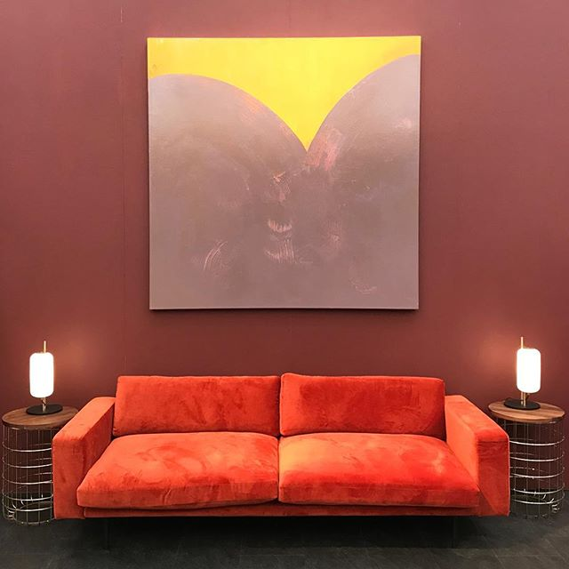 I dream of having a wall large enough for one of @sarawaldrondare 's pieces! Complimented by this burnt orange @dare_studio Riley sofa and Wire side tables. #Darestudio #decorex2018 #ldf2018