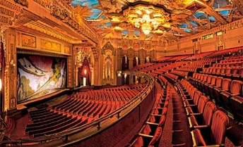 Performing arts theatres in the USA offering some performances with audio description.