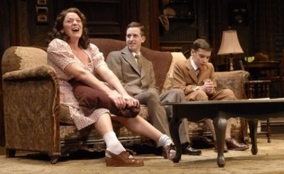"From left, Sara Surrey as Bella, Alex Wyse as Jay, and Maxwell Beer as Arty, share a wistful moment on the coach, in the Paper Mill Playhouse production of ""Lost in Yonkers."" (Photo by Peter Jennings, courtesy of Cleveland Play House)"