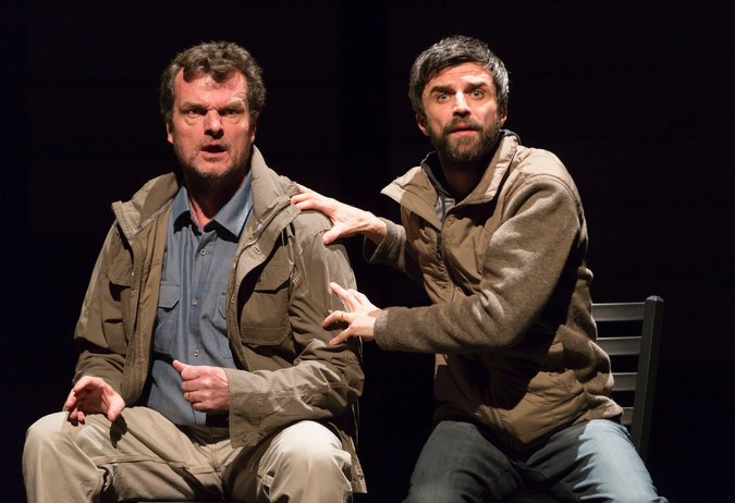 "Michael Cumpsty and Michael Crane play the photographer Paul Watson and the playwright Dan O'Brien in ""The Body of an American."" Credit T. Charles Erickson"