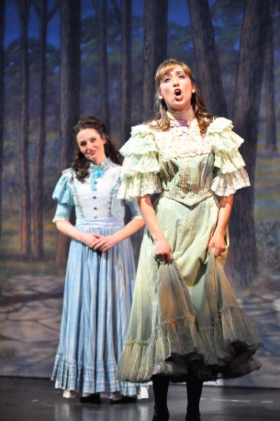 Jennifer Ellis as Julie Jordan (left) and Jessica Kundla as Carrie Pipperidge. Courtesy Reagle Music Theatre/©Herb Philpott