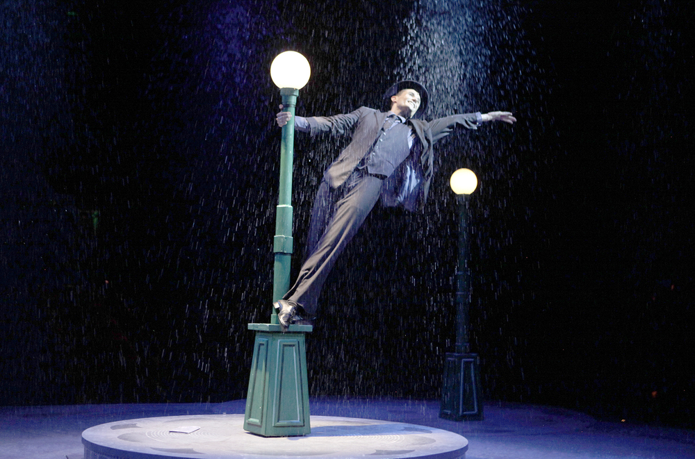 """a review of singin in the """"singin' in the rain"""" is not considered the muny family show this season that's """"annie"""" and perhaps """"the wiz"""" but """"singin' in the rain"""" is so full of life, motion and color that no one's too young or too old for it."""