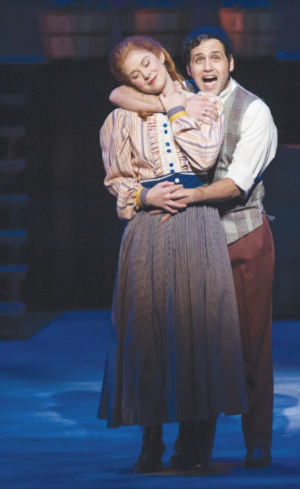 "Carrie (Amanda Hootman) and Enoch Snow (Justin Cowden) sing ""When the Children Are Asleep"" in Musical Theatre West's Carousel (Caught in the Moment Photography)"