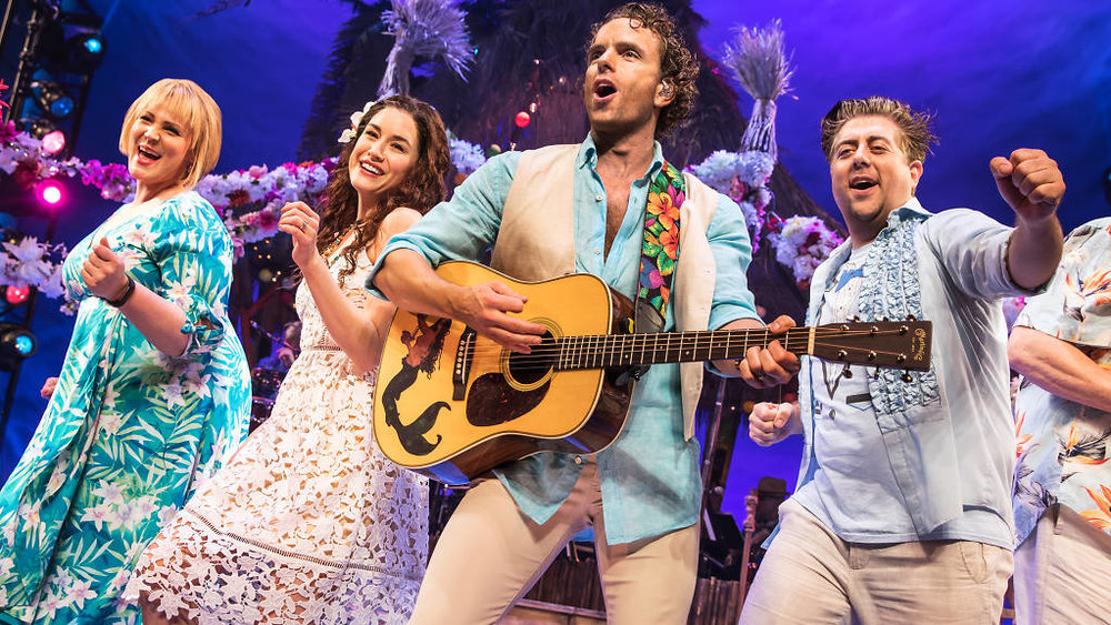 "Photo: Lisa Howard, Alison Luff, Paul Alexander Nolan and Eric Petersen in ""Escape to Margaritaville."" Credit: Matthew Murphy."