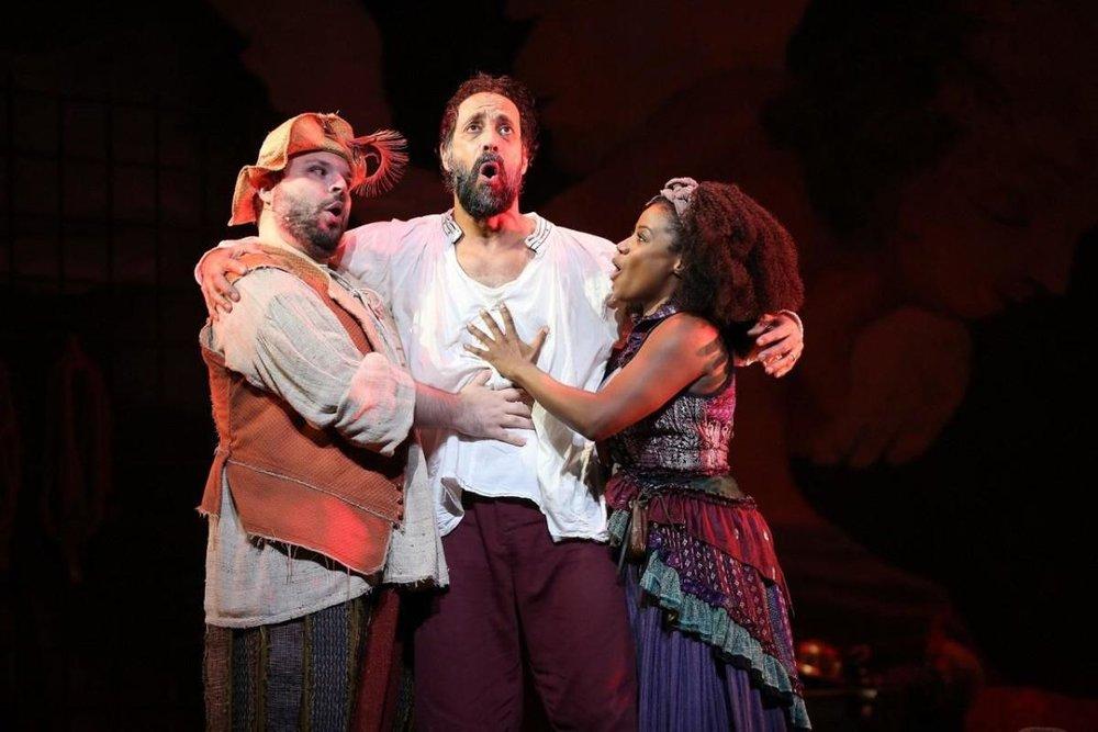"From left, Tony Manna as Sancho Panza, Philip Hernandez as Don Quixote, and Gisela Adisa as Aldonza in ""Man of La Mancha."" Photo by Carol Rosegg"