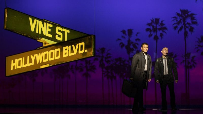 "Conrad Ricamora, left, and Francis Jue star in ""Soft Power,"" a David Henry Hwang play with Jeanine Tesori music having its world premiere at the Ahmanson Theatre. (Gina Ferazzi / Los Angeles Times)"