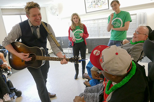 Sing for Hope volunteers brought joy to the residents of ADAPT's Belsky House on Martin Luther King Day.