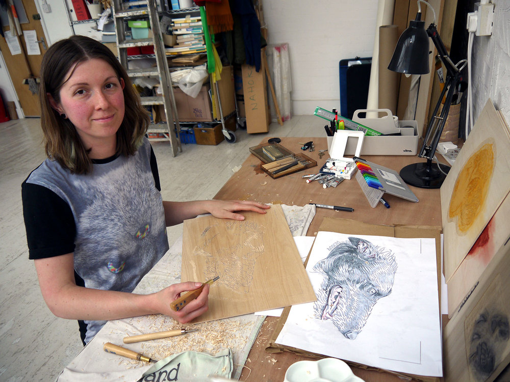 Abi cutting the grey block for Woody in the studio