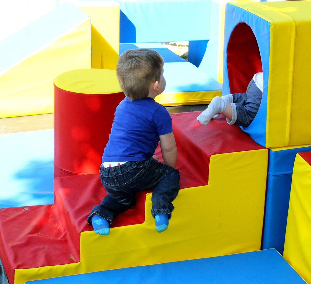 Children climbing on the soft play at a party