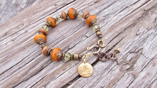 Up cycled wooden mala beads, Nepalese brass capped resin, and honey colored Czech glass with vermeil Lotus flower.