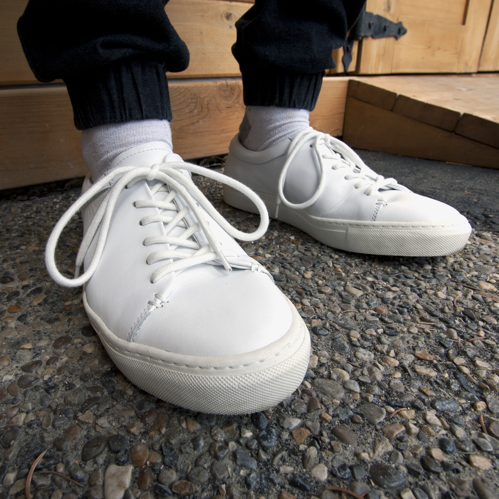 The Frank & Oak leather offerings are my favorite all-white sneakers in the menswear world right now, precisely because they are as true-to-style and elegant as you can get. Simple construction, quality materials, and consistent colouring all make them fantastic.  you can find them at Frank & Oak  here