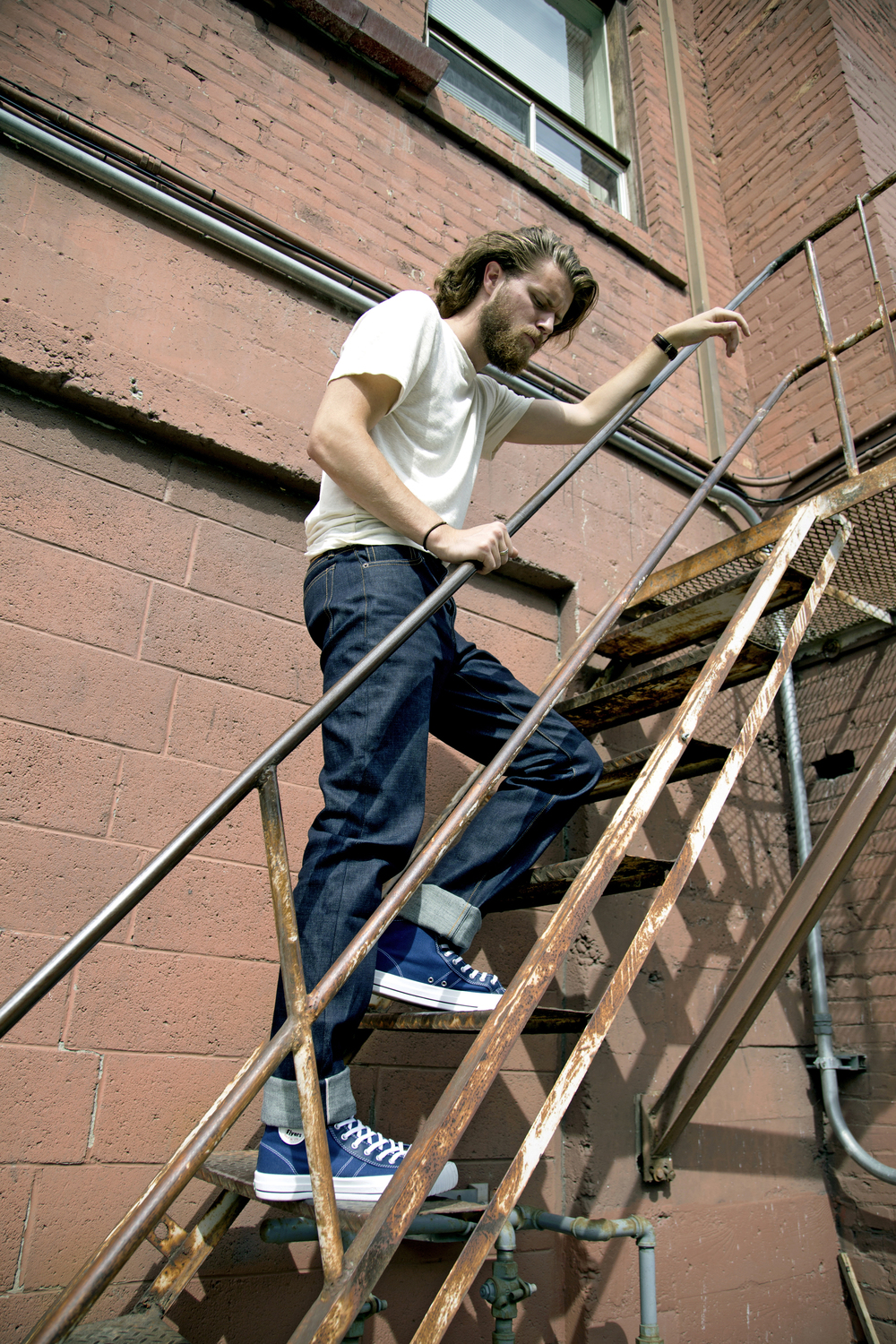 Model Brad Beal in PF Flyers shoes, Left Field NYC denim, and a Jungmaven hemp tee, all from  North American Quality Purveyors