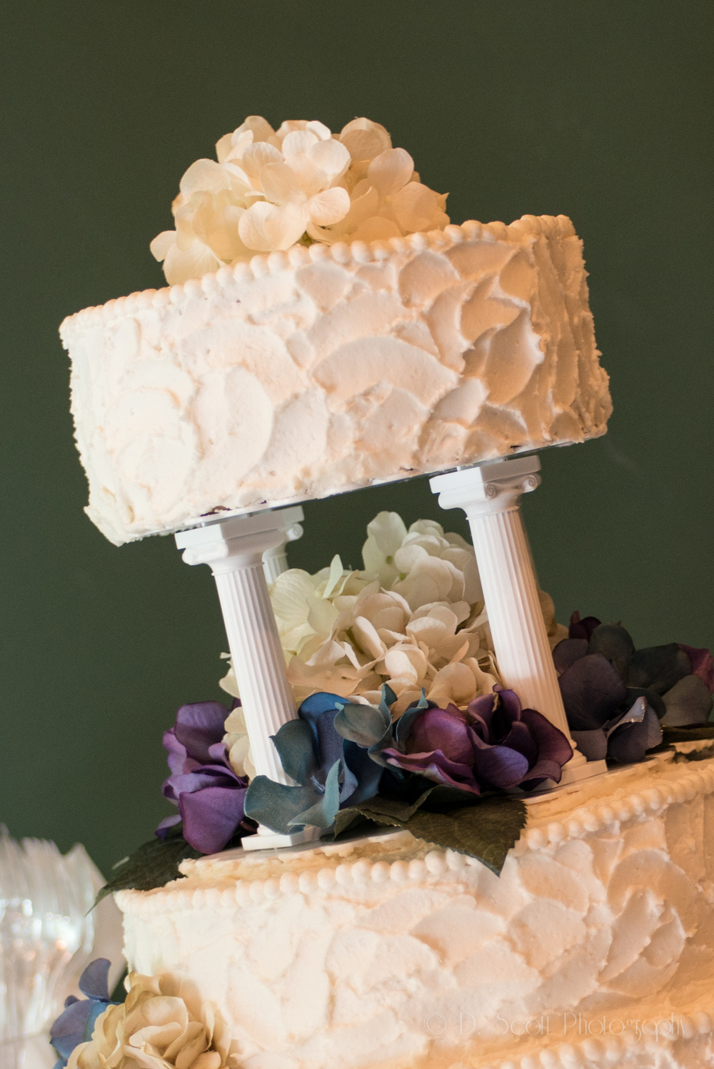 Tiered cakes with fresh flowers