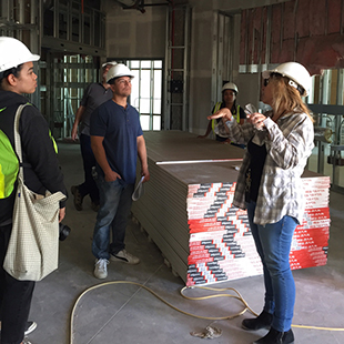Design Director, Jeanmarie Zimmerman, and PDA studio team tour site.