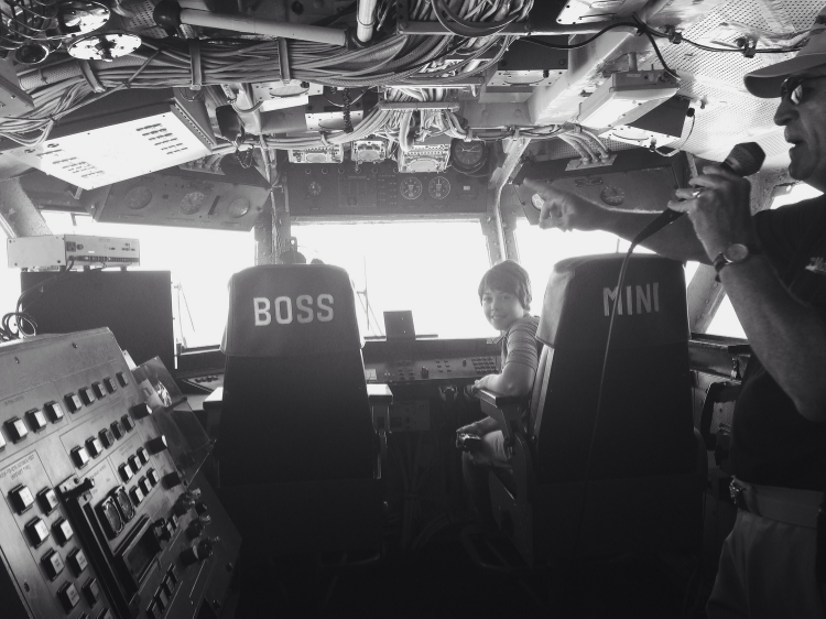 Ellie sitting in the control tower. Love the boss/mini designations.