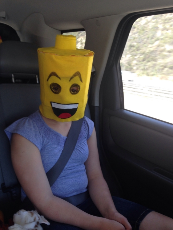 Taking the Halloween Lego head home....but first, she had to wear it awhile