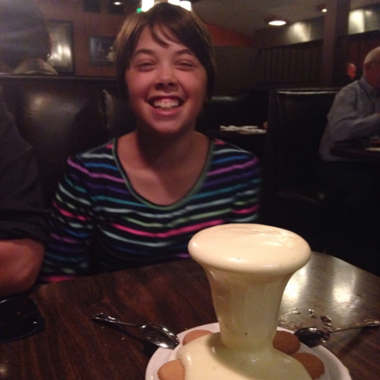 Overflowing zabaglione with vanilla wafers.  Ellie looks pleased to dig in!