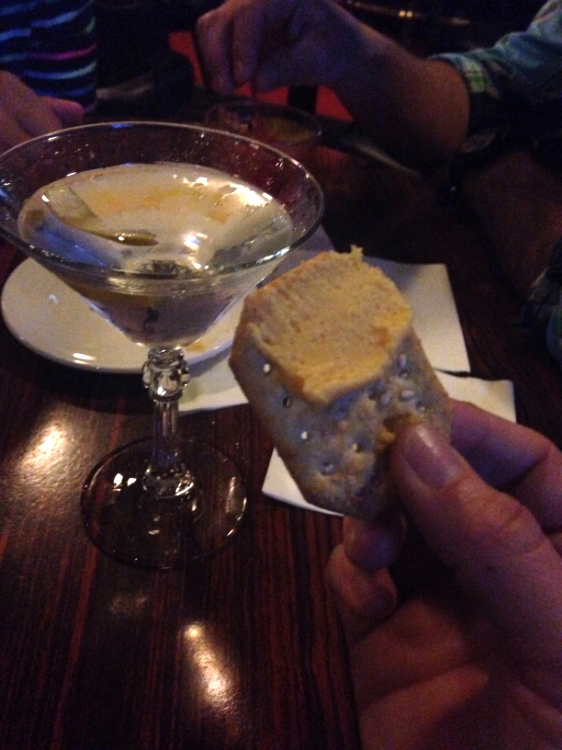Hendrick's martini and complimentary crackers and cheese.