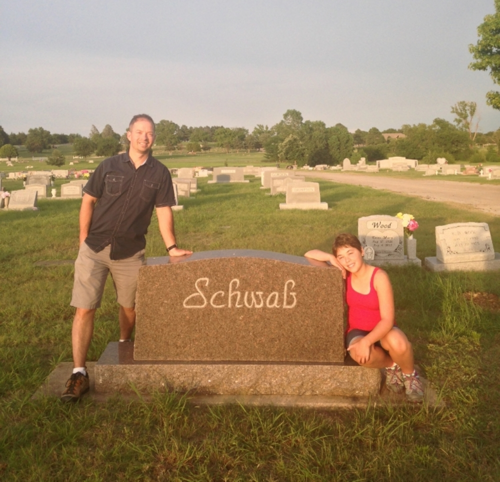 Visiting the family headstone.