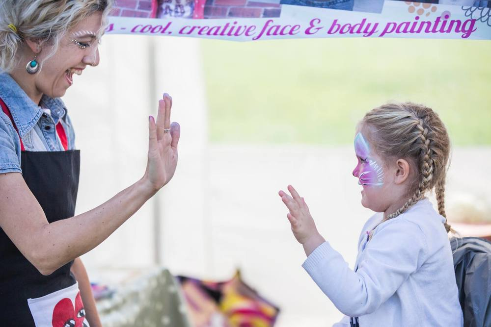 This is how Natasha got the name Hi5! For obvious reasons, she needed to give the kids the highest of fives.