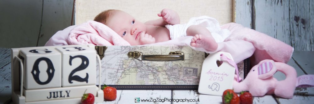 newborn-photography-photoshoot-baby-props-suitcase-date-announcement-studio-leicester.jpg
