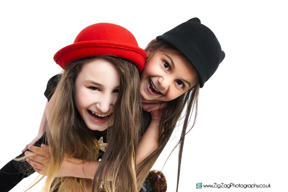 leicester-photography-studio-leicester-photoshoot-girls-sisters-children-fun-ideas-red-hat.jpg