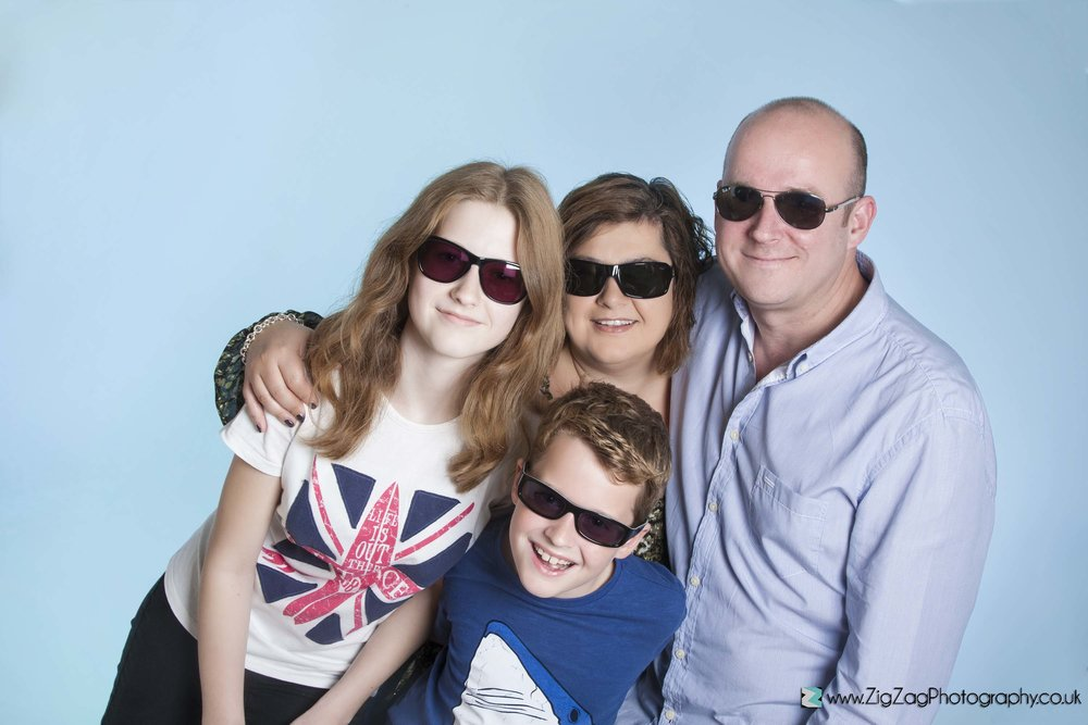 photography-leicester-photoshoot-session-zigzag-sunglassess-summer-blue-background-mum-dad-boy-girl.jpg